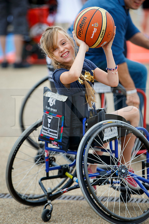 © Licensed to London News Pictures. 03/09/2016. LONDON, UK. Raynie Foxon plays paralympics basketball with a wheelchair to experience the disability sports at National Paralympic Day and Liberty Festival in Queen Elizabeth Olympic Park in London on Saturday 3 Spetember 2016. Photo credit : Tolga Akmen/LNP