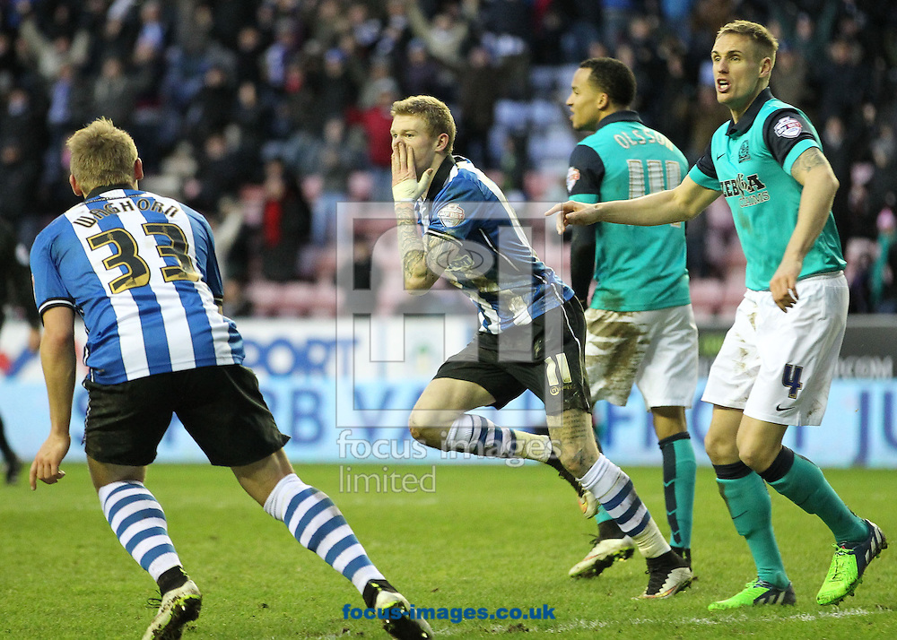 James McClean of Wigan Athletic celebrates scoring the equalising goal against Blackburn Rovers during the Sky Bet Championship match at the DW Stadium, Wigan.<br /> Picture by Michael Sedgwick/Focus Images Ltd +44 7900 363072<br /> 17/01/2015
