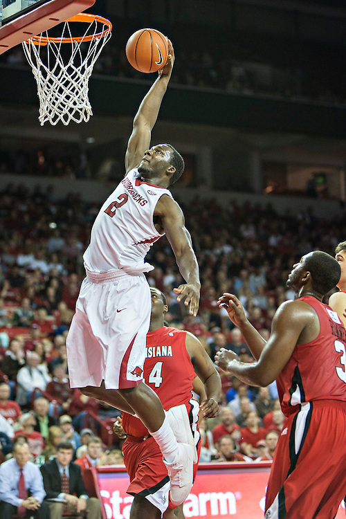 FAYETTEVILLE, AR - NOVEMBER 15:  Alandise Harris #2 of the Arkansas Razorbacks goes up for a dunk against the Louisiana Ragin' Cajuns at Bud Walton Arena on November 15, 2013 in Fayetteville, Arkansas.  The Razorbacks defeated the Ragin' Cajuns 76-63.  (Photo by Wesley Hitt/Getty Images) *** Local Caption *** Alandise Harris