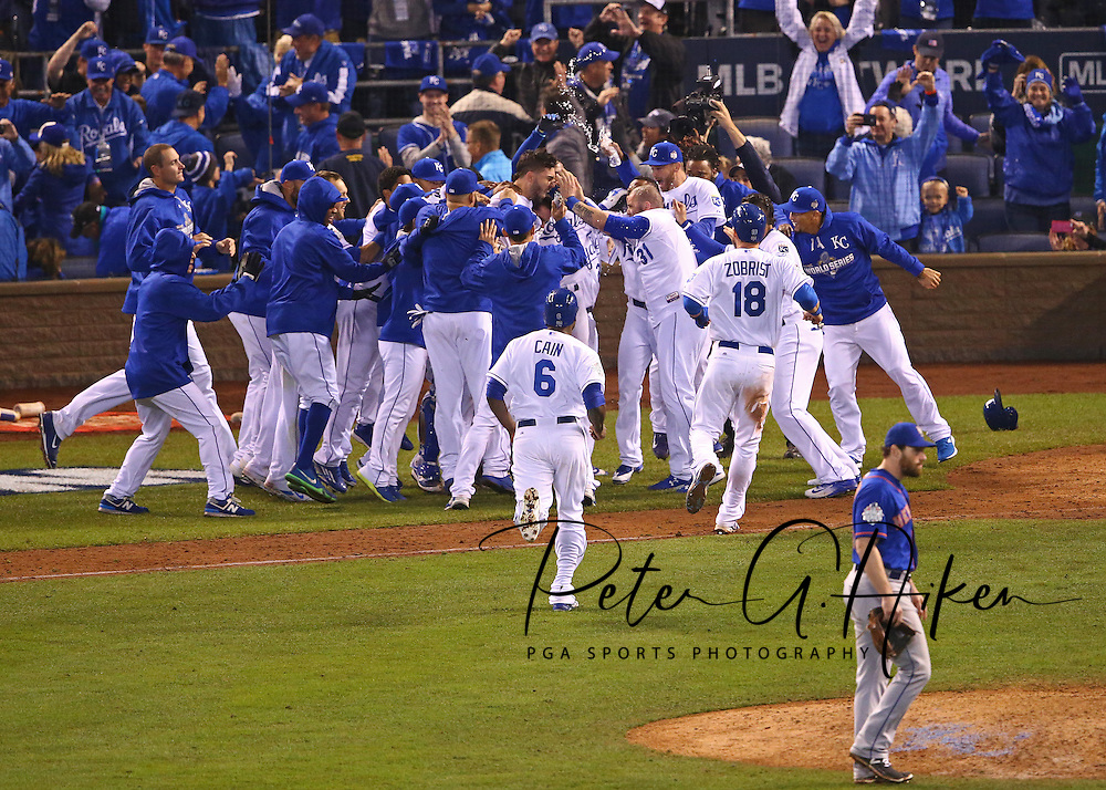 Oct 27, 2015; Kansas City, MO, USA; Kansas City Royals first baseman Eric Hosmer (35) celebrates with teammates after driving in the winning run against the New York Mets in the 14th inning in game one of the 2015 World Series at Kauffman Stadium. Mandatory Credit: Peter G. Aiken-USA TODAY Sports