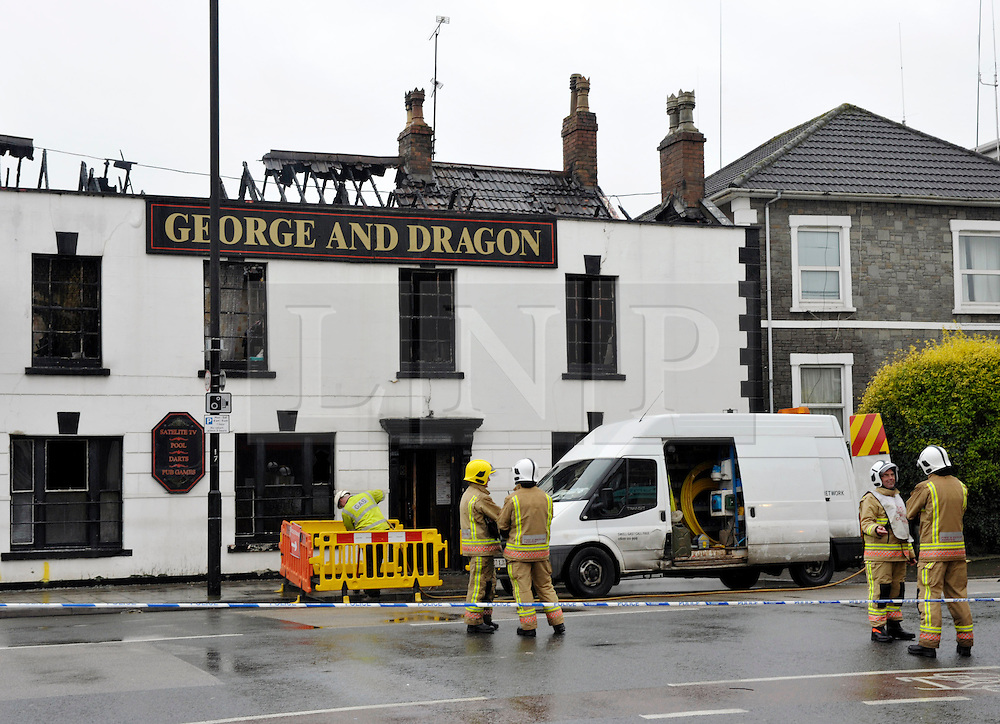 © Licensed to London News Pictures. 14/01/2013. Bristol, UK. A pub called the George and Dragon pub in Church Road, Redfield, Bristol had its roof destroyed by fire last night and 40 firefighters attended.  It is thought the blaze may have been started deliberately.  The road was closed to traffic for several hours.  The pub is just down the road from another pub called the Fire Engine.  14 January 2013..Photo credit : Simon Chapman/LNP