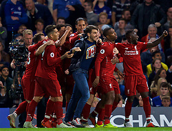 LONDON, ENGLAND - Saturday, September 29, 2018: Liverpool's Daniel Sturridge (second right) celebrates with team-mates and a supporter after scoring a late equalising goal to grab the Reds a 1-1 draw during the FA Premier League match between Chelsea FC and Liverpool FC at Stamford Bridge. (Pic by David Rawcliffe/Propaganda)