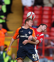 Charlton's Frazer Richardson battles with Oldham's Joe Colbeck<br /> Coca Cola League One. Charlton v Oldham. 10.10.09<br /> Photo By Karl Winter Fotosports International
