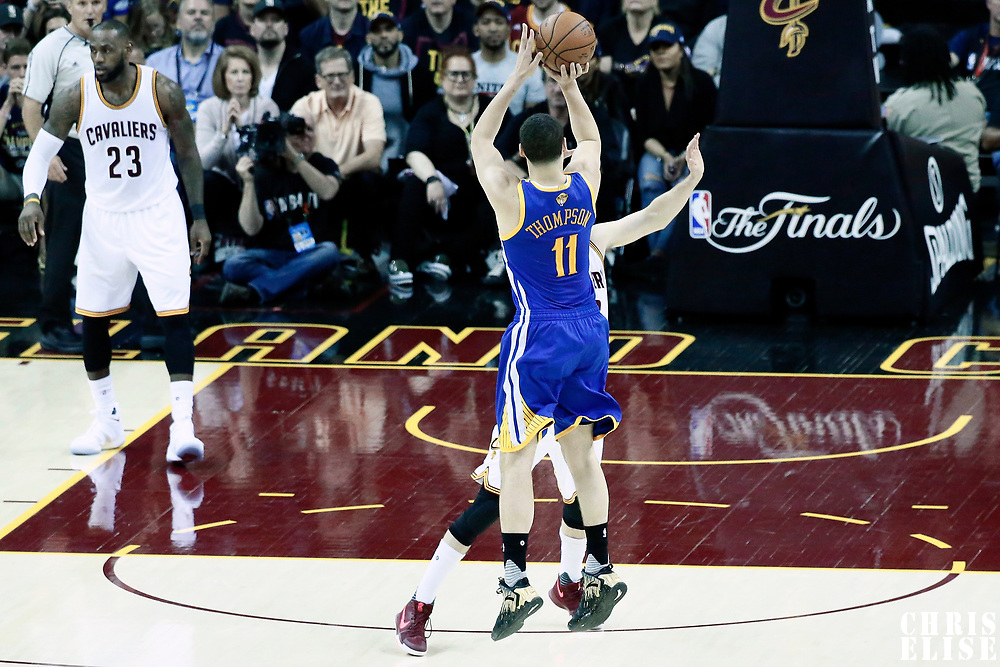 07 June 2017: Golden State Warriors guard Klay Thompson (11) takes a jump shot during the Golden State Warriors 118-113 victory over the Cleveland Cavaliers, in game 3 of the 2017 NBA Finals, at  the Quicken Loans Arena, Cleveland, Ohio, USA.