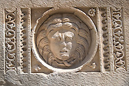 A stone carving of a head in the ruins at<br /> Myra on the south coast of Turkey<br /> c. Ellen Rooney
