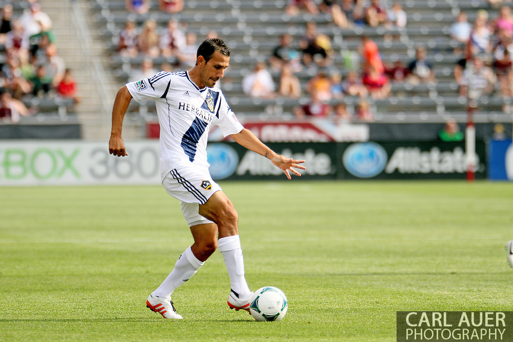July 27th, 2013 - Former Colorado Rapids captain and now a member of the LA Galaxy, midfielder Pablo Mastroeni (6) handles the ball in the first half of action in the Major League Soccer match between the LA Galaxy and the Colorado Rapids at Dick's Sporting Goods Park in Commerce City, CO