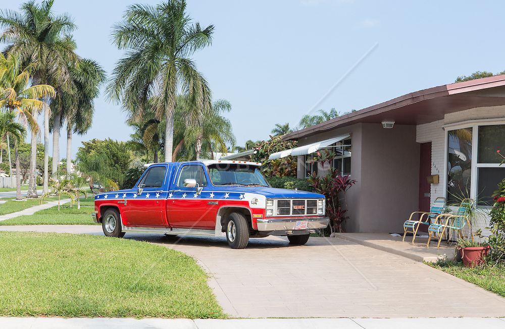 red white and blue patriotic painted unusual two driver truck in Florida