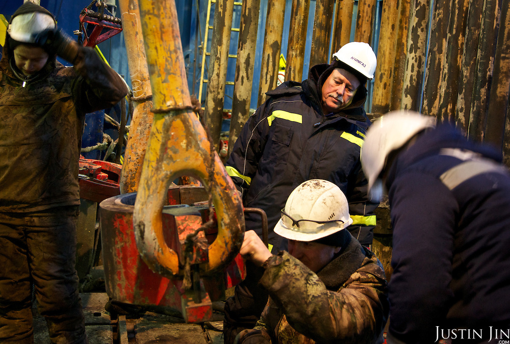 Drilling manager Oleg Klimovich supervises a subcontractor at Achimgaz gas drilling well in Novy Urengoi, Siberia, Russia.