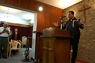 Pastor Bechara Karkafi from Lebenon preaches at the new National Evangelical Baptist Church in Baghdad..Baghdad, Iraq. 03/04/2004..Photo © J.B. Russell