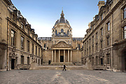 Cour d'honneur or courtyard of honour, in Louis XIII style, and Chapelle de la Sorbonne behind, at the Sorbonne, the main building of the University of Paris in the 5th arrondissement of Paris, France. The building now houses several faculties created when the Sorbonne was divided up into 13 universities in 1970. The chapel, or La Chapelle Sainte Ursule de la Sorbonne, was built 1635-42 by architect Jacques Lemercier, under Cardinal Richelieu, who is also buried here. The statue of Victor Hugo still bears traces of red paint from the unrest of May 1968. The chapel is listed as a historic monument. Picture by Manuel Cohen
