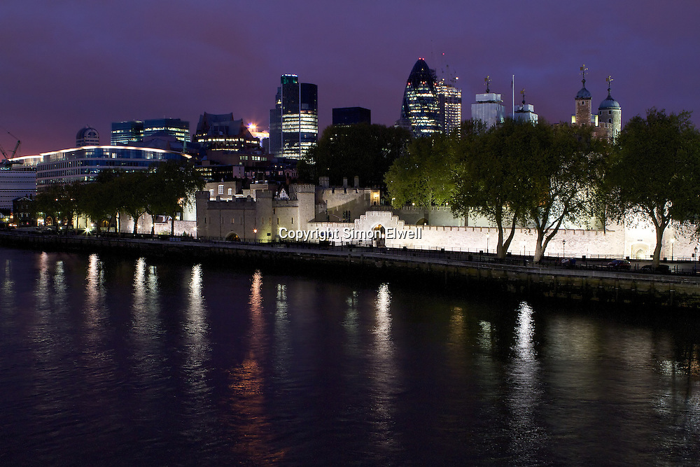 Tower of London at Night shot from Tower Bridge with the City in the background