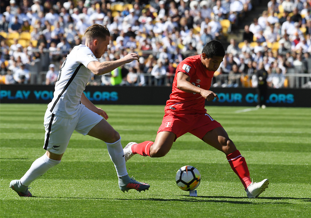 Peru's Edison Flores, right, runs pass New Zealand's Michael McGlinchey in the Soccer World Cup qualifying match, Westpac Stadium, Wellington, New Zealand, Saturday, November 11, 2017. Credit:SNPA / Ross Setford  **NO ARCHIVING**