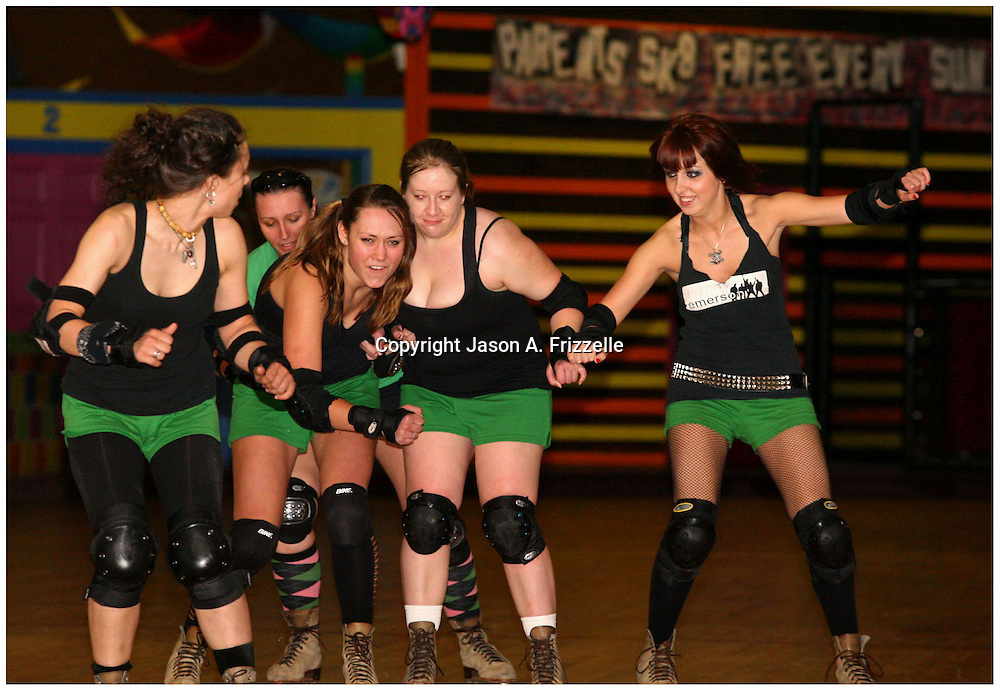 Becky Durham, Hope, Celeste Lajoine, Samantha Kauffman, and Jenn Angele, members of the Greenville Rollergirls practice at Galaxy Sports in Kinston, N.C.