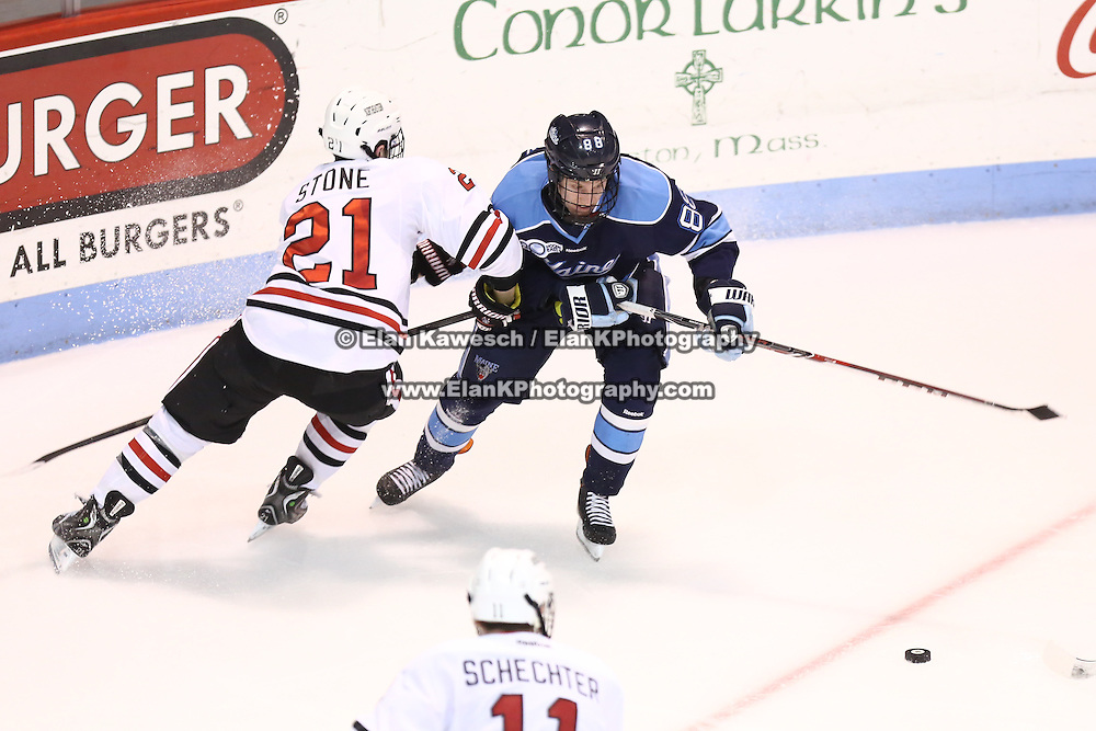 Brian Morgan #88 of the Maine Black Bears tries to get past Zak Stone #21 of the Northeastern Huskies during the game at Matthews Arena on February 22, 2014 in Boston, Massachusetts. (Photo by Elan Kawesch)