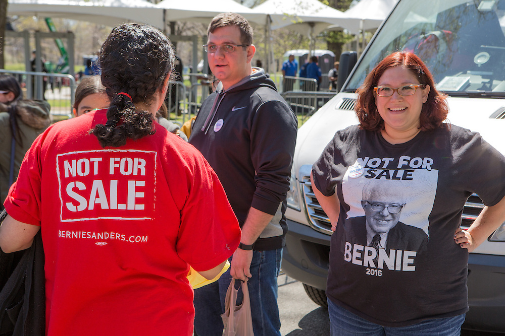 "Brooklyn, NY - 17 April 2016. Two women wear T-shirts captions ""Not for Sale"" wait to get into the rally. Vermont Senator Bernie Sanders, who is running as a Democrat in the U.S. Presidential primary elections, held a campaign ""get out the  vote"" rally in Brooklyn's Prospect Park."