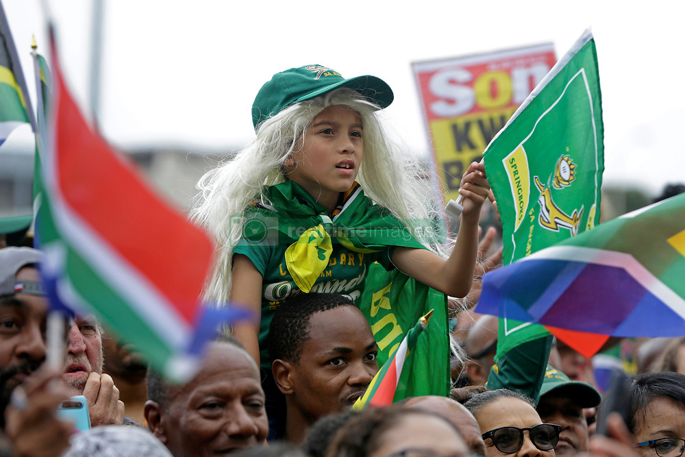 Monday 11th November 2019.<br /> City Hall, Grand Parade,<br /> And City Centre, Cape Town,<br /> Western Cape,<br /> South Africa.<br /> <br /> SPRINGBOKS CELEBRATE WINNING THE RUGBY WORLD CUP CHAMPIONSHIP IN 2019 WITH A COUNTRYWIDE VICTORY TOUR!<br /> <br /> SPRINGBOKS RUGBY WORLD CUP VICTORY TOUR CAPE TOWN!<br /> <br /> A young girl wearing a long blonde wig and green Springbok cap waits with thousands of other excited fans on Cape Town's Grand Parade for the Springboks to arrive.<br /> <br /> The reigning Rugby World Cup Champions namely the South African Springbok Rugby Team, celebrates winning the Webb Ellis Cup during the International Rugby Football Board Rugby World Cup Championship held in Japan in 2019 with their Victory Tour that culminated in the final city tour taking place in Cape Town. Thousands of South African fans filled the streets of the city all trying their best to show their support for their beloved Springboks and to celebrate them winning the Rugby World Cup for the third time. South Africa previously won the Rugby World Cup in 1995, 2007 and now again in 2019. South African Springbok Captan Siya Kolisi took the opportunity to speak to the gathered crowd about how something like this brings unity and that we should live together as a nation that practices what is known as ubuntu. Ubuntu is a quality that includes the essential human virtues of compassion and humanity. This image taken in Cape Town on Monday 11th November 2019.<br /> <br /> This image is the property of Seven Bang Media Group (Pty) Ltd, hereinafter referred to as SBM.<br /> <br /> Picture By: SBM / Mark Wessels. (11/11/2019).<br /> +27 (0)61 547 2729<br /> mark@sevenbang.com<br /> www.sevnbang.com<br /> <br /> Copyright © SBM. All Rights Reserved.