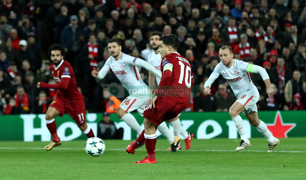 Liverpool's Philippe Coutinho scores his side's first goal of the game from the penalty spot during the UEFA Champions League, Group E match at Anfield, Liverpool.
