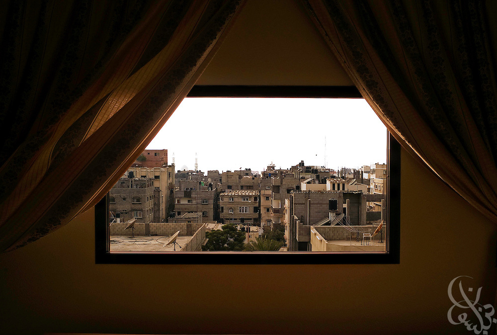The Gaza skyline is seen through an open window in the Shatta Camp in central Gaza, Palestinian Territories on August 3, 2007..