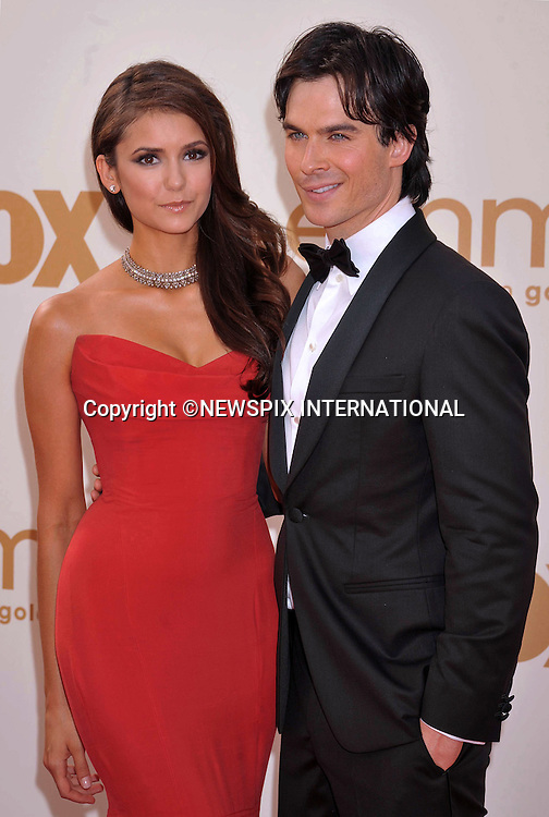 """NINA DOBREV AND IAN SOMERHALDER.attends the Academy of Television Arts & Sciences 63rd Primetime Emmy Awards at Nokia Theatre L.A. Live, Los Angeles_18/09/2011.Mandatory Photo Credit: ©Crosby/Newspix International. .**ALL FEES PAYABLE TO: """"NEWSPIX INTERNATIONAL""""**..PHOTO CREDIT MANDATORY!!: NEWSPIX INTERNATIONAL(Failure to credit will incur a surcharge of 100% of reproduction fees).IMMEDIATE CONFIRMATION OF USAGE REQUIRED:.Newspix International, 31 Chinnery Hill, Bishop's Stortford, ENGLAND CM23 3PS.Tel:+441279 324672  ; Fax: +441279656877.Mobile:  0777568 1153.e-mail: info@newspixinternational.co.uk"""