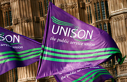 ©London News Pictures. 09/02/2011. Unison flags fly at the PCS Union rally against the Public Bodies Bill outside Parliament London on 9/2/2011. Photo credit should read: Craig Shepheard/London News Pictures