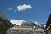 The wooden roof of a municipal building beneath the highest peaks in the Slovenian Julian Alps, on 22nd June 2018, in Trenta, Triglav National Park, Slovenia. Nearby mountains are Kreiski 2050m, Pihavec 2419m, Dolina Zadnjica and Triglav 2864m.