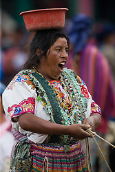 Woman yawning at market, San Francisco El Alto,Guatemala