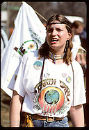 Young woman wears Earth Day t-shirt, buttons & Indian jewelry at Earth Day fair in St. Louis. Missouri