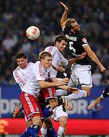 FUSSBALL   1. BUNDESLIGA    SAISON 2012/2013    8. Spieltag   Hamburger SV - VfB Stuttgart            21.10.2012 Marcus Berg, Artjoms Rudnevs und Dennis Diekmeier (v.l., alle Hamburger SV) gegen Georg Niedermeier (re, VfB Stuttgart)