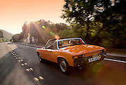Automotive Car Photographer, Writer and Videographer Randy Wells, Image of an orange targa sportscar on a country road in Camarillo, California, west coast, Porsche 914/6, model and property released