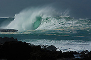 Giant winter surf batters Oahu's North Shore at Shark's Cove, Hawaii