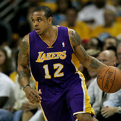 April 22, 2011; New Orleans, LA, USA; Los Angeles Lakers point guard Shannon Brown (12) against the New Orleans Hornets during the first half in game three of the first round of the 2011 NBA playoffs at the New Orleans Arena. The Lakers defeated the Hornets 100-86.   Mandatory Credit: Derick E. Hingle