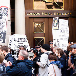 London, UK - 15 June 2012: activists in front of the London Metal Exchange during the Carnival of Dirt. More than 30 activist groups from London and around the world have come together to highlight the illicit deeds of mining and extraction companies.