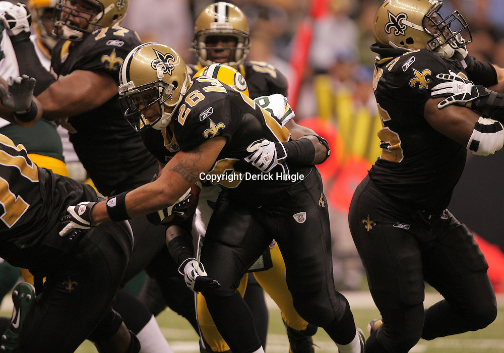 2008 November, 24: New Orleans Saints running back Deuce McAllister (26) is grabbed from behind by Green Bay Packers safety Nick Collins (36) on his way to a touchdown run during 51-29 victory by the New Orleans Saints over the Green Bay Packers on Monday Night Football at the Louisiana Superdome in New Orleans, LA.