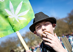 © Licensed to London News Pictures. 20/04/2016. London, UK. A man smokes cannabis at the '4/20' demonstration in Hyde Park. Demonstrators gather on 20 April for the legalisation of cannabis. Photo credit : Tom Nicholson/LNP