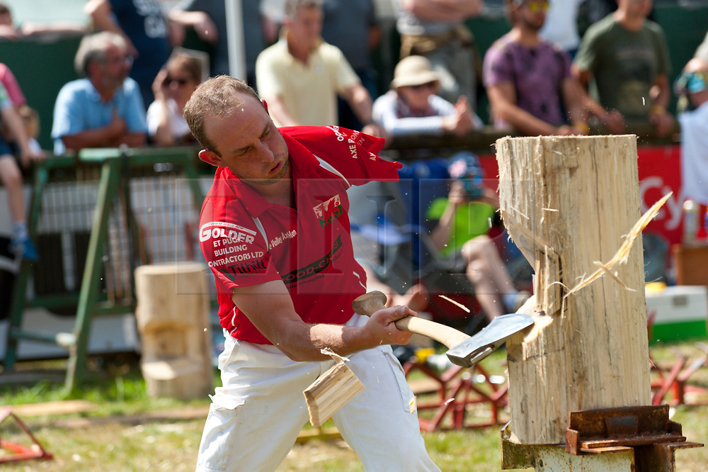 © Licensed to London News Pictures. 25/07/2017. Llanelwedd, Powys, Wales, UK. One armed Nick Fredriksen competes in the Division 3 Axeman Standing Block Heat in the forestry area on the second day of The Royal Welsh Show. Fredriksen of Kilkoy, Queensland, Australia, who lives on a 1,200 acre beef cattle farm, lost his left arm at the age of eight when it accidentally got caught in the PDO shaft of a haybaler. Frederiksen's trip to Wales has been funded by fellow axemen and incorporates fundraising events for the Welsh Air Ambulance. The Royal Welsh Agricultural Show is hailed as the largest & most prestigious event of its kind in Europe. In excess of 200,000 visitors are expected this week over the four day show period. The first ever show was at Aberystwyth in 1904 and attracted 442 livestock entries. Photo credit: Graham M. Lawrence/LNP