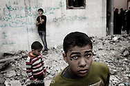 Gaza City: Palestinian children are seen on the rubble of a house after was bombed by Israeli Air Force. November 17, 2012. ALESSIO ROMENZI