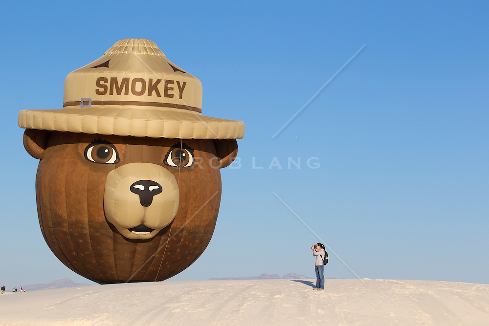 hot air balloon festival in White Sands National Park, New Mexico with Smokey The Bear Balloon and a photographer