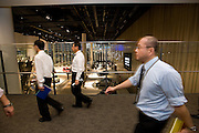 """******FOR MAGAZINE*******.Employees of Nissan Motor Co. head to a """"town hall"""" meeting with president Carlos Ghosn at the automaker's headquarters in Yokohama, Japan on Monday 19 Oct.  2009. .Photographer: Robert Gilhooly/Bloomberg News"""