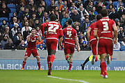 Middlesbrough FC defender Daniel Ayala runs to his teammate midfielder Grant Leadbitter to celebrate Middlesbroughs second goal during the Sky Bet Championship match between Brighton and Hove Albion and Middlesbrough at the American Express Community Stadium, Brighton and Hove, England on 19 December 2015. Photo by Geoff Penn.