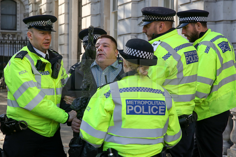 © Licensed to London News Pictures. 18/10/2019. London, UK. Police detains a Pro-Brexit supporter outside the Cabinet Office. Prime Minister BORIS JOHNSON is carrying out talks with MPs before tomorrow's debate and vote on his new Brexit deal.  Photo credit: Dinendra Haria/LNP