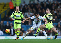 Yeovil Town's Kevin Dawson battles with Leeds United's Alex Mowatt-Photo mandatory by-line: Matt Bunn/JMP - Tel: Mobile: 07966 386802 02/11/2013 - SPORT - FOOTBALL - Elland Road - Leeds - Leeds United v Yeovil Town - Sky Bet Championship