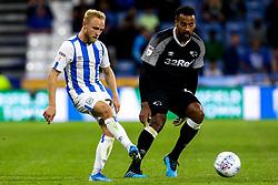 Alex Pritchard of Huddersfield Town takes on Tom Huddlestone of Derby County - Mandatory by-line: Robbie Stephenson/JMP - 05/08/2019 - FOOTBALL - The John Smith's Stadium - Huddersfield, England - Huddersfield Town v Derby County - Sky Bet Championship