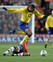 Photo: Richard Lane.<br />Southampton v Arsenal. Barclaycard Premiership.<br />29/12/2003.<br />Thierry Henry beats the challenge by Rory Delap.
