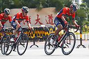 Meiyin Wang (CHN - Bahrain - Merida), Hermann Pernsteiner (AUT - Bahrain - Merida) during the Tour of Guangxi 2018, stage 1, Beihai - Beihai 107,4 km on October 16, 2018 in Beihai, China - Photo Luca Bettini / BettiniPhoto / ProSportsImages / DPPI