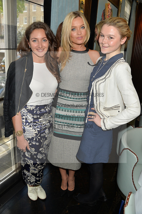 Left to right, NATASHA CORRETT, LAURA WHITMORE and AMBER ATHERTON at the 'Ladies of Influence Lunch' held at Marcus, The Berkeley Hotel, London on 12th May 2014.