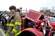 March 31, 2013 - Garden City, New York, U.S. - The Garden City Volunteer Exempt Firemans Association brought its 1932 Ford Fire Engine and posters about recruiting volunteers to the 58th Annual Easter Sunday Vintage Car Parade and Show sponsored by the Garden City Chamber of Commerce. Hundreds of authentic old motorcars, 1898-1988, including antiques, classic, and special interest participated in the parade.