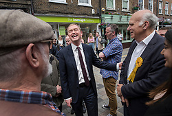 © Licensed to London News Pictures. 07/06/2017. Twickenham, UK. Liberal Democrat leader Tim Farron laughs as he campaigns in Twickenham with local candidate Vince Cable (R) on the last day of the election before the polls open. Photo credit: Peter Macdiarmid/LNP