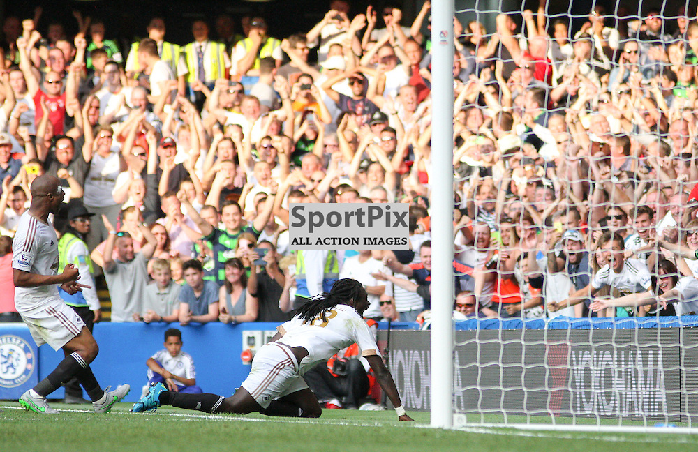 Bafitembi Gomis celebrates his goal with Andre Ayew and the swansea fans During Chelsea vs Swansea on the 8th August 2015.