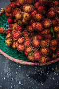 Basket filed with rambutan fruits, Hanoi, Vietnam, Southeast Asia