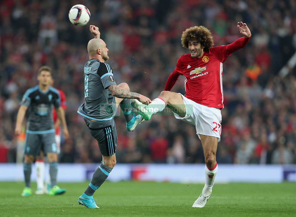 Celta Vigo's John Guidetti (left) and Manchester United's Marouane Fellaini battle for the ball